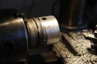 <p>After chopping the throttle body in half with a hack saw and removing excess bits with an angle grinder it was time to turn it down on the lathe.</p>
